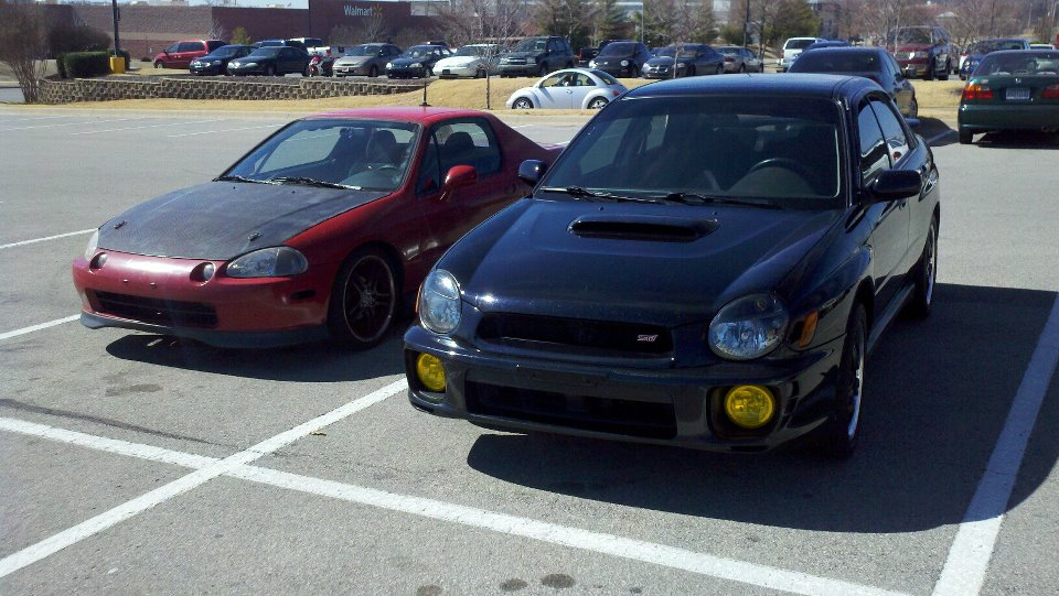 My new bugeye sitting next to my co-workers supercharged Del Sol