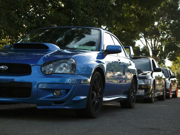Half of our crew back in the day, Evo VIII behing me and an '04 sti behind IT