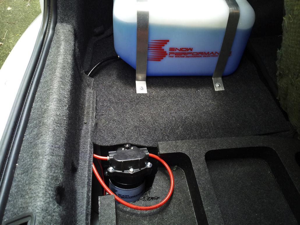 Trunk view with Snow Performance pump and reservoir.