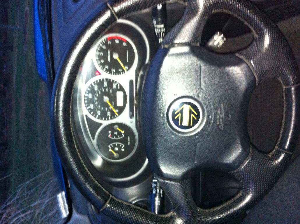 Steering wheel, gauges.